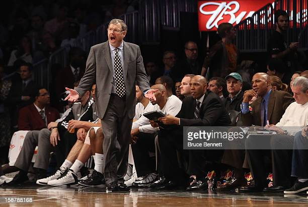 Interim Coach PJ Carlesimo of the Brooklyn Nets handles bench duries against the Charlotte Bobcats at the Barclays Center on December 28 2012 in the...