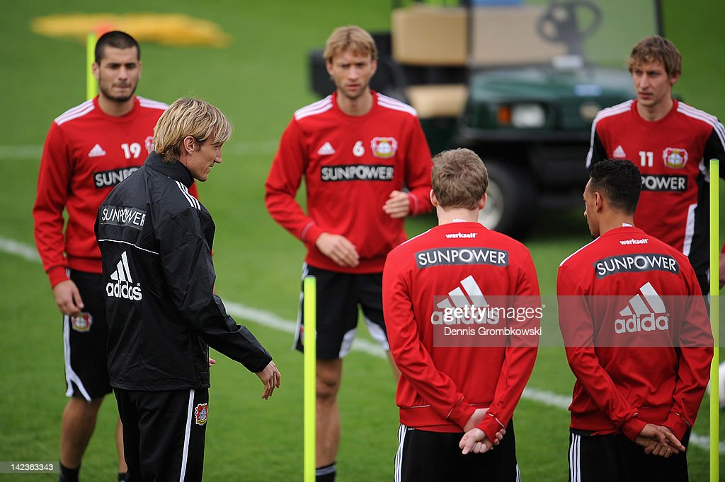 Interim coach Sami Hyypia of Leverkusen talks to his players during a training session at the Bayer 04 Leverkusen training ground on April 3 2012 in...