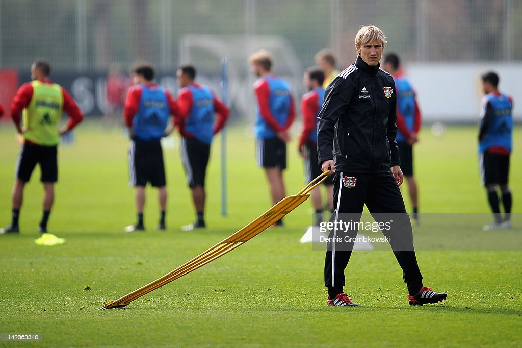 Interim coach Sami Hyypia of Leverkusen walks on the pitch during a training session at the Bayer 04 Leverkusen training ground on April 3 2012 in...