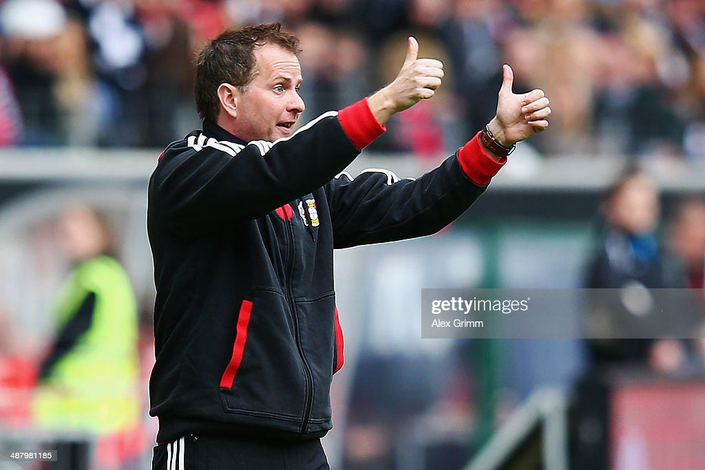 Interim coach <a gi-track='captionPersonalityLinkClicked' href=/galleries/search?phrase=Sascha+Lewandowski&family=editorial&specificpeople=5134760 ng-click='$event.stopPropagation()'>Sascha Lewandowski</a> of Leverkusen shows thumbs up during the Bundesliga match between Eintracht Frankfurt and Bayer Leverkusen at Commerzbank Arena on May 3, 2014 in Frankfurt am Main, Germany.