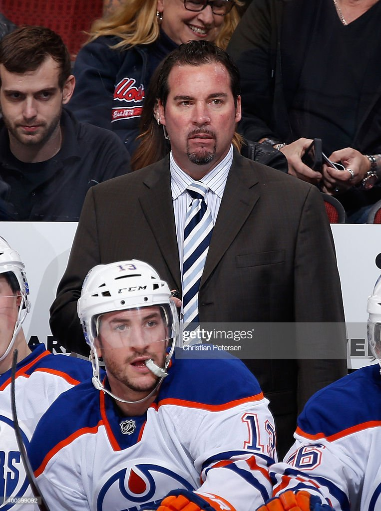 Interim coach Todd Nelson of the Edmonton Oilers on the bench during the NHL game against the Arizona Coyotes at Gila River Arena on December 16, 2014 in Glendale, Arizona. The Coyotes defeated the Oilers 2-1 in overtime.