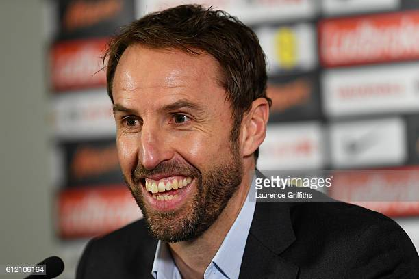 Interim England manager Gareth Southgate smiles during an England press conference at St George's Park on October 3 2016 in BurtonuponTrent England