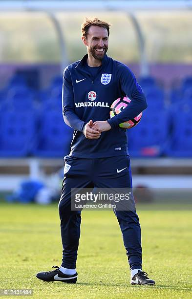 Interim England manager Gareth Southgate smiles during an England training session at St George's Park on October 4 2016 in BurtonuponTrent England