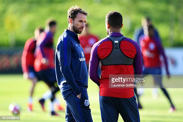 Interim England manager Gareth Southgate speaks with Ryan Bertrand during an England training session at St George's Park on October 4 2016 in...