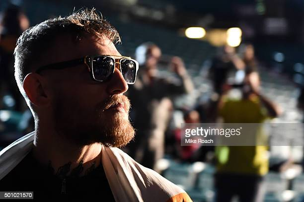 UFC interim featherweight champion Conor McGregor of Ireland waits backstage before stepping on the scale during the UFC 194 weighin inside MGM Grand...
