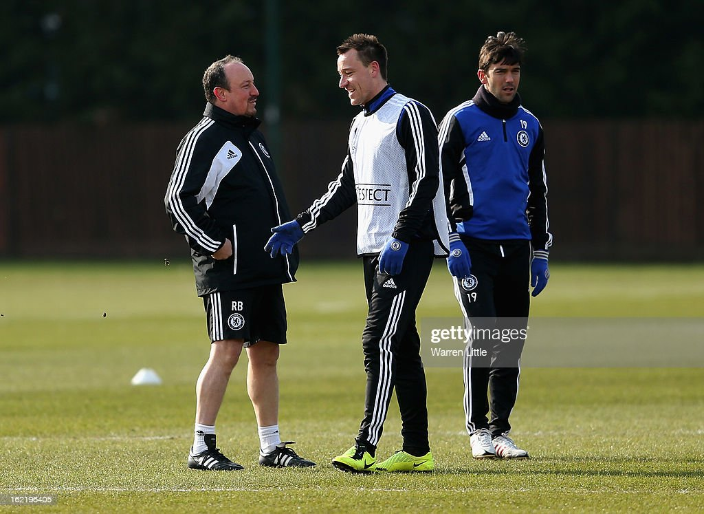 Interim First-Team Manager of Chelsea, Rafael Benitez speaks with John Terry of Chelsea during a training session at Cobham training ground on February 20, 2013 in Cobham, England.
