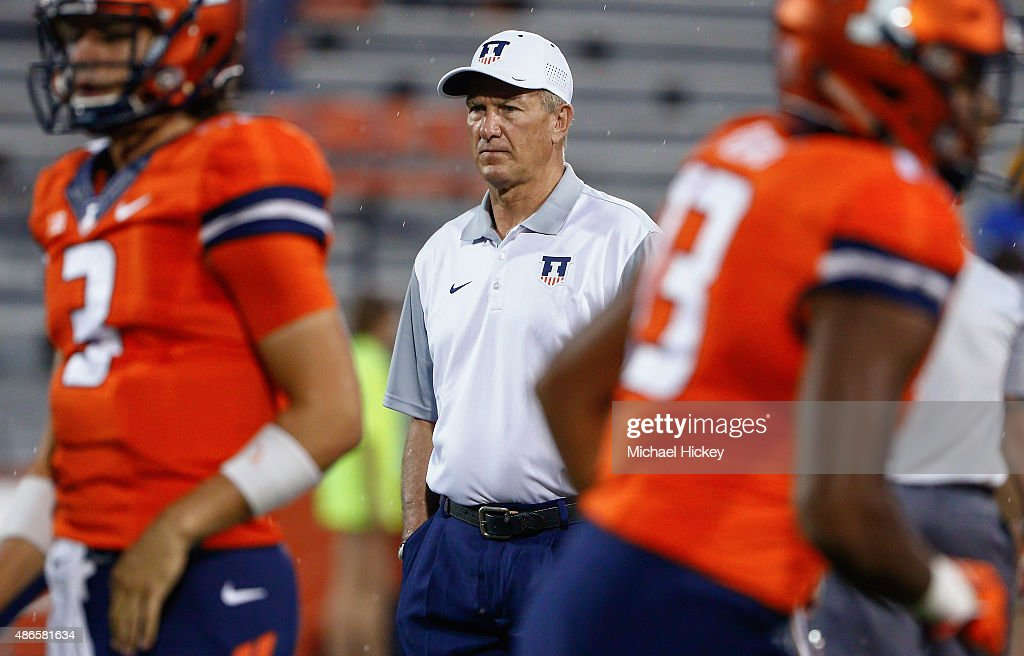 Interim head coach Bill Cubit of the Illinois Fighting Illini is seen on the field during pregame before the game against the Kent State Golden...