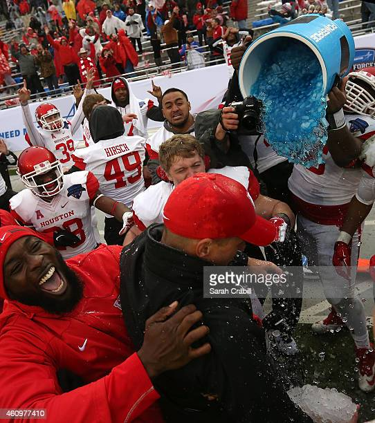 Interim Head Coach David Gibbs of the Houston Cougars celebrates after defeating the Pittsburgh Panthers during the Lockheed Martin Armed Forces Bowl...