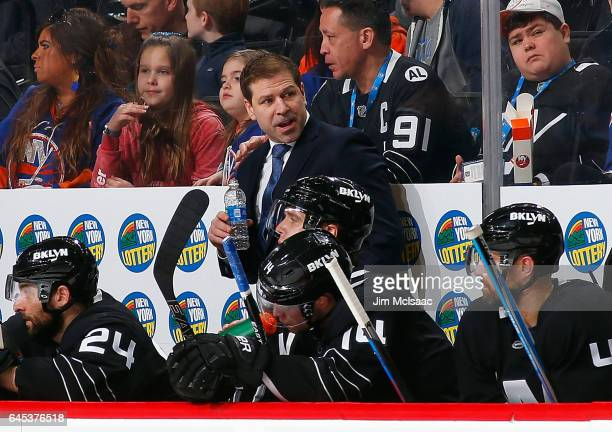 Interim head coach Doug Weight looks on during a game against the New Jersey Devils on February 19 2017 at Barclays Center in the Brooklyn borough of...