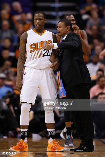 Interim head coach Earl Watson of the Phoenix Suns talks with Archie Goodwin during the NBA game against the Oklahoma City Thunder at Talking Stick...