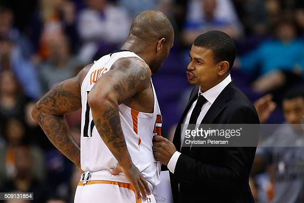 Interim head coach Earl Watson of the Phoenix Suns talks with PJ Tucker during the second half of the NBA game against the Oklahoma City Thunder at...