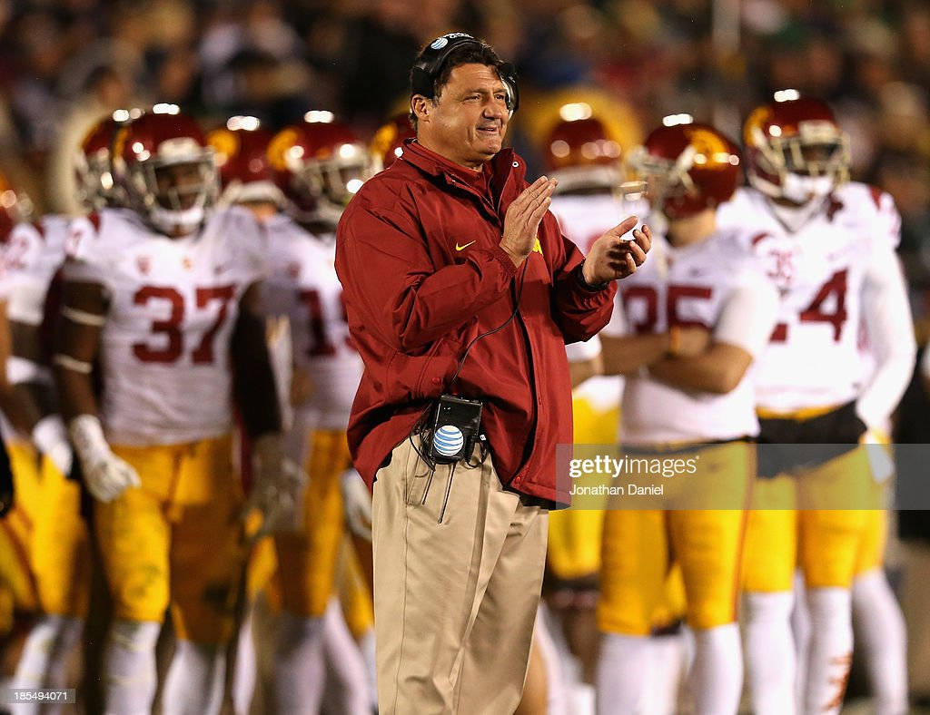Interim head coach Ed Orgeron of the University of Southern California Trojans watches as his team takes on the Notre Dame Fighting Irish at Notre Dame Stadium on October 19, 2013 in South Bend, Indiana. Notre Dame defeated USC