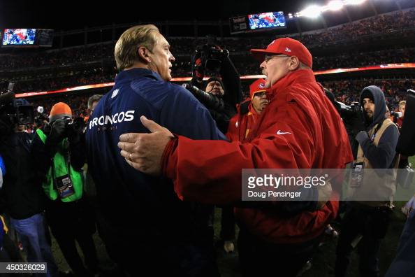 Interim head coach Jack Del Rio of the Denver Broncos and head coach Andy Reid of the Kansas City Chiefs meet after the game at Sports Authority...