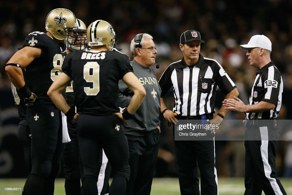 Interim Head coach Joe Vitt of the New Orleans Saints talks with Referee John Parry during a timeout against the San Francisco 49ers at The Mercedes-Benz Superdome on November 25, 2012 in New Orleans, Louisiana.