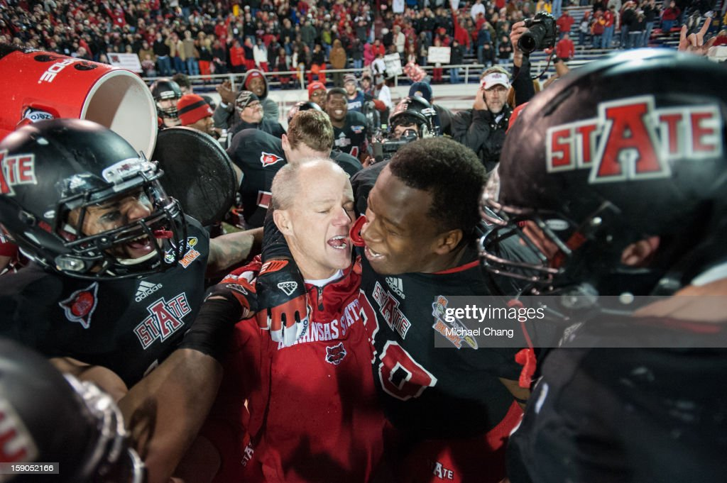 Interim head coach John Thompson of the Arkansas State Red Wolves celebrates with his players after defeating the Kent State Golden Flashes on January 6, 2013 at Ladd-Peebles Stadium in Mobile, Alabama. Arkansas State defeated Kent State 17-13.