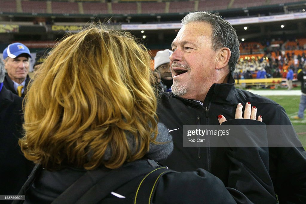 Interim head coach Kent Baer of the San Jose State Spartans embraces his girlfriend Erika Brunke after the Spartans defeated the Bowling Green Falcons 29-20 to win the Military Bowl at RFK Stadium on December 27, 2012 in Washington, DC.