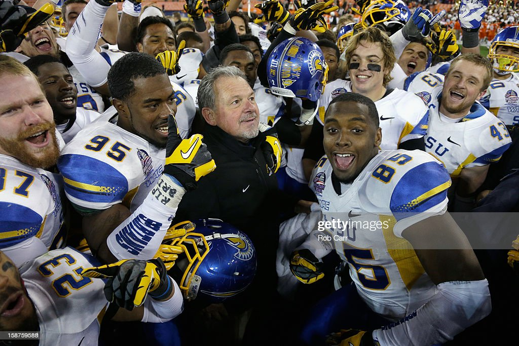 Interim head coach Kent Baer of the San Jose State Spartans celebrates with his players after defeating the Bowling Green Falcons 29-20 to win the Military Bowl at RFK Stadium on December 27, 2012 in Washington, DC.