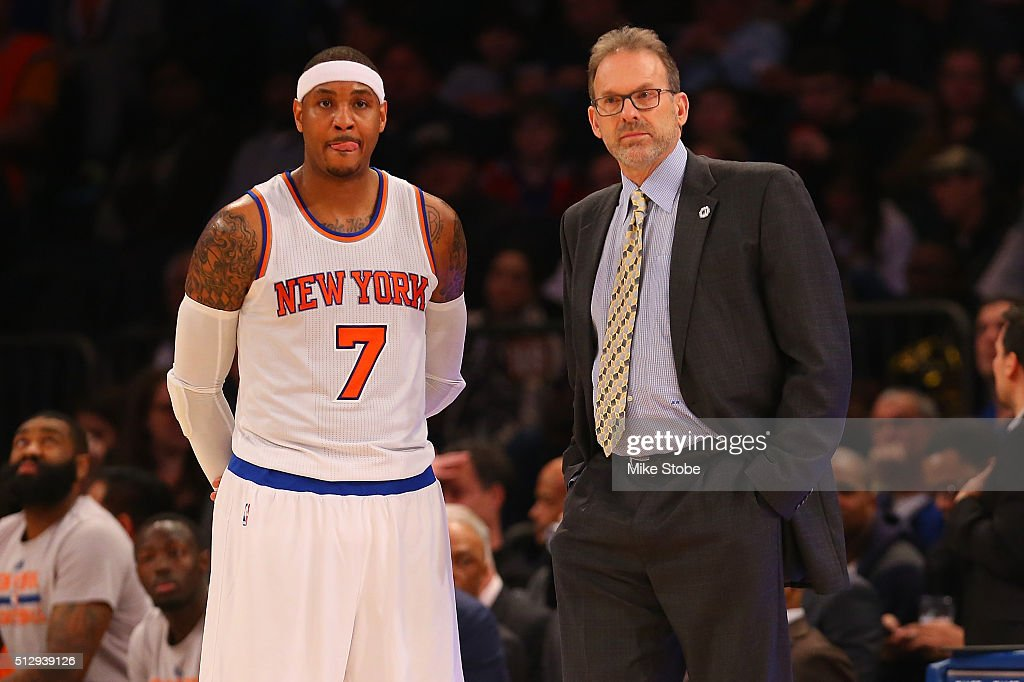 Interim head coach Kurt Rambis and Carmelo Anthony of the New York Knicks look on against the Miami Heat at Madison Square Garden on February 28 2016...