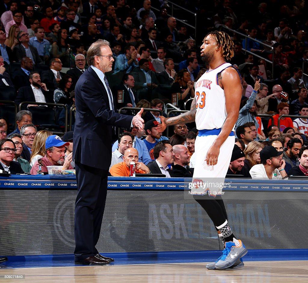 Interim head coach Kurt Rambis of the New York Knicks shakes hands with Derrick Williams of the New York Knicks during the game against the...
