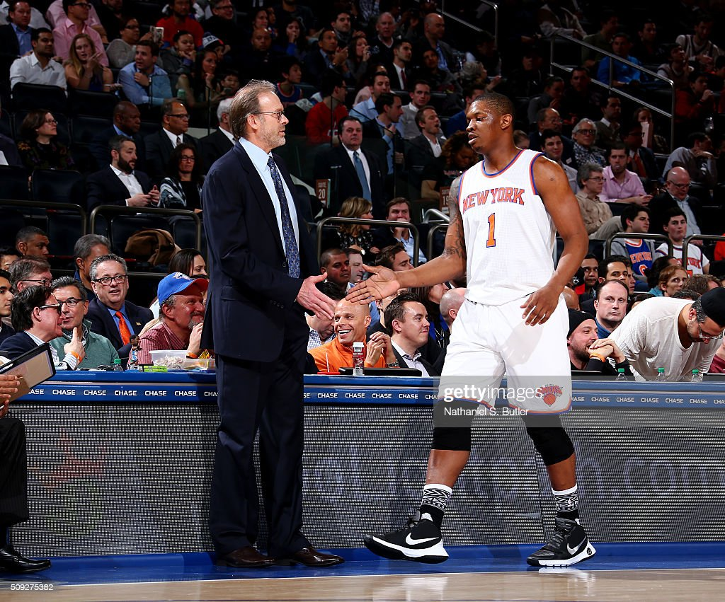 Interim head coach Kurt Rambis of the New York Knicks shakes hands with Kevin Seraphin of the New York Knicks during the game against the Washington...