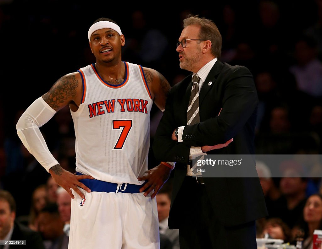 Interim head coach Kurt Rambis of the New York Knicks talks with Carmelo Anthony during a free throw in the second half against the Portland Trail...