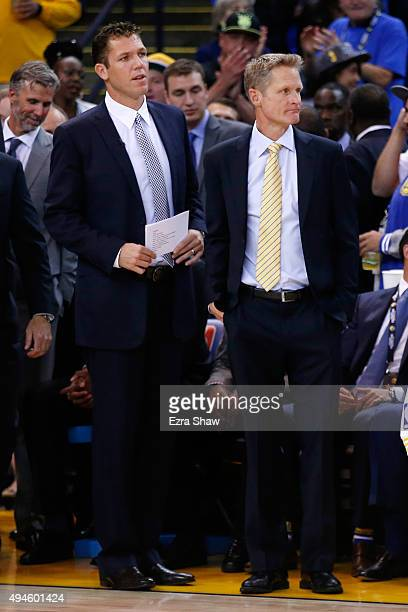 Interim head coach Luke Walton and head coach Steve Kerr of the Golden State Warriors stand by the bench prior to the NBA season opener at ORACLE...