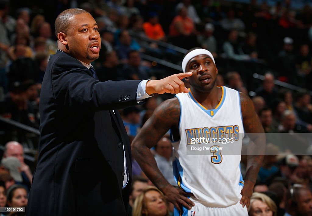 Interim head coach Melvin Hunt of the Denver Nuggets leads Ty Lawson and the Nuggets against the Milwaukee Bucks at Pepsi Center on March 3 2015 in...