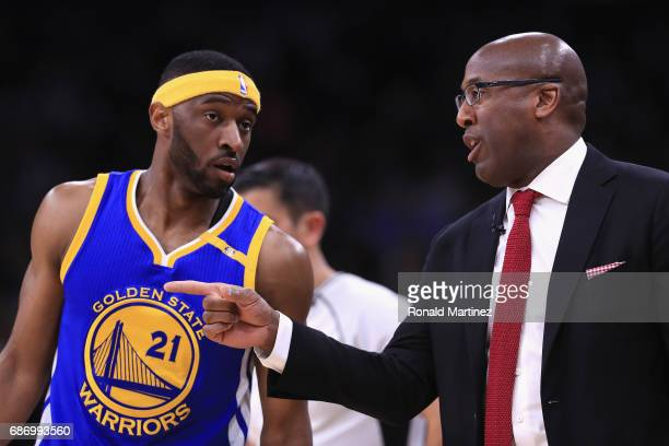 Interim head coach Mike Brown of the Golden State Warriors talks with Ian Clark in the first half against the San Antonio Spurs during Game Four of...