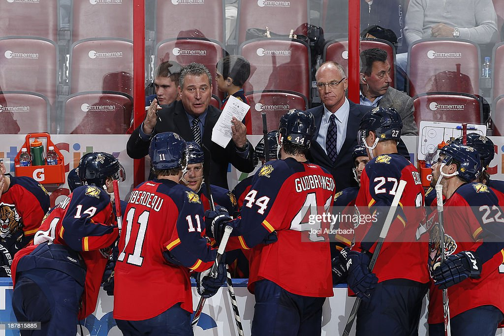 Interim head coach Peter Horachek of the Florida Panthers directs players during a timeout against the Anaheim Ducks at the BB&T Center on November 12, 2013 in Sunrise, Florida. Horachek got his first victory as coach of the Panthers. The Panthers defeated the Ducks 3-2.