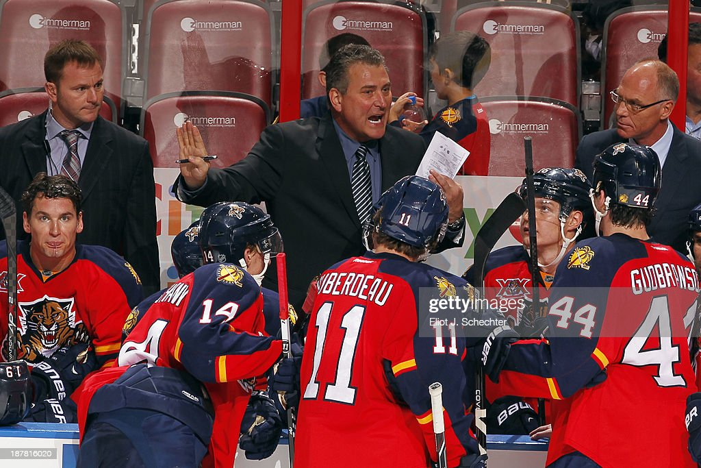 Interim Head Coach Peter Horachek of the Florida Panthers directs his team from the bench with Assistant Coaches Brian Skrudland and <a gi-track='captionPersonalityLinkClicked' href=/galleries/search?phrase=John+Madden+-+Hockey+Player&family=editorial&specificpeople=14046726 ng-click='$event.stopPropagation()'>John Madden</a> during a break in the action against the Anaheim Ducks at the BB&T Center on November 12, 2013 in Sunrise, Florida.
