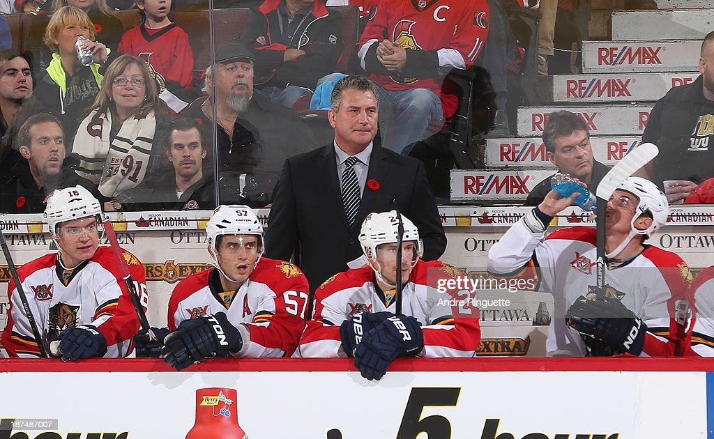 Interim head coach Peter Horachek of the Florida Panthers looks on from behind the bench in an NHL game against the Ottawa Senators at Canadian Tire Centre on November 9, 2013 in Ottawa, Ontario, Canada.