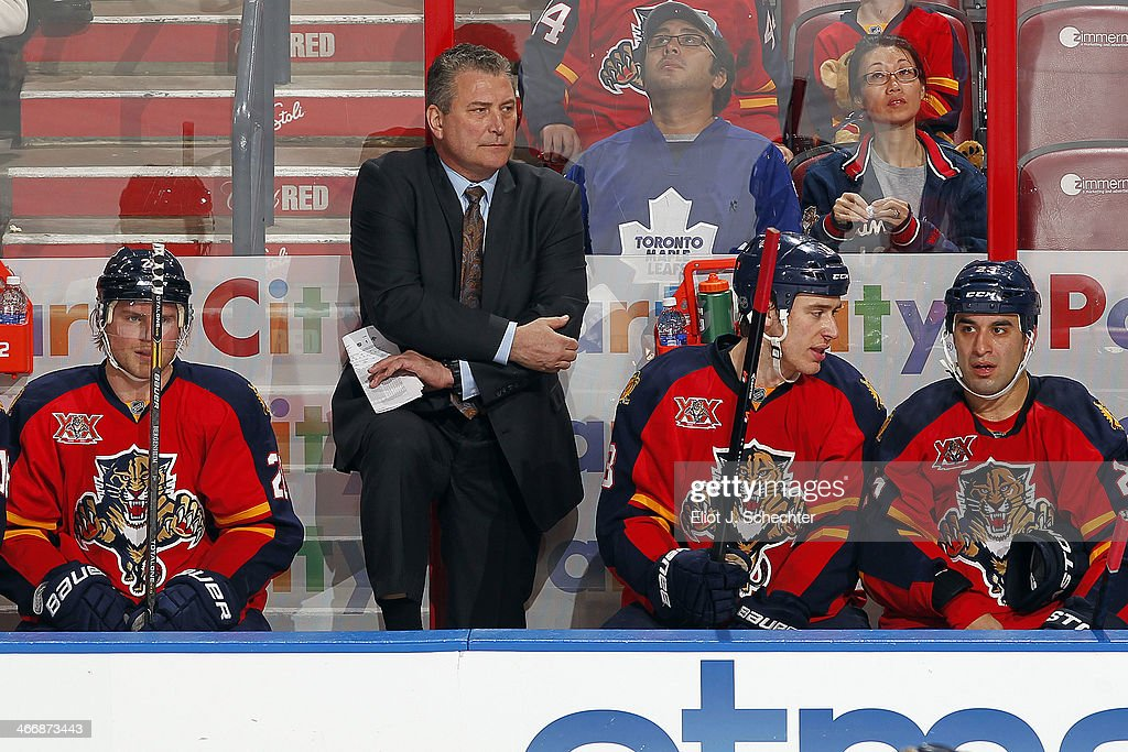 Interim head coach Peter Horachek of the Florida Panthers watches the action from the bench against the Toronto Maple Leafs at the BB&T Center on February 4, 2014 in Sunrise, Florida.
