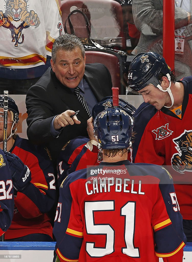 Interim head coach Peter Horachek talks to <a gi-track='captionPersonalityLinkClicked' href=/galleries/search?phrase=Brian+Campbell+-+Ice+Hockey+Player&family=editorial&specificpeople=209384 ng-click='$event.stopPropagation()'>Brian Campbell</a> #51 of the Florida Panthers during a break in action against the Anaheim Ducks at the BB&T Center on November 12, 2013 in Sunrise, Florida. The Panthers defeated the Ducks 3-2. Horachek got his first victory as the Panther's coach.