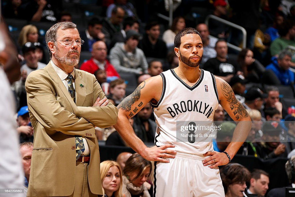 Interim Head Coach P.J. Carlesimo of the Brooklyn Nets and Deron Williams #8 look on from the sideline during a game against the Atlanta Hawks on March 17, 2013 at the Barclays Center in the Brooklyn borough of New York City.