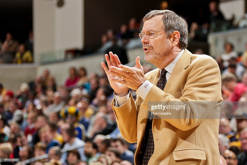 Interim Head Coach <a gi-track='captionPersonalityLinkClicked' href=/galleries/search?phrase=P.J.+Carlesimo&family=editorial&specificpeople=243247 ng-click='$event.stopPropagation()'>P.J. Carlesimo</a> of the Brooklyn Nets applauds his team against the Indiana Pacers on February 11, 2013 at Bankers Life Fieldhouse in Indianapolis, Indiana.