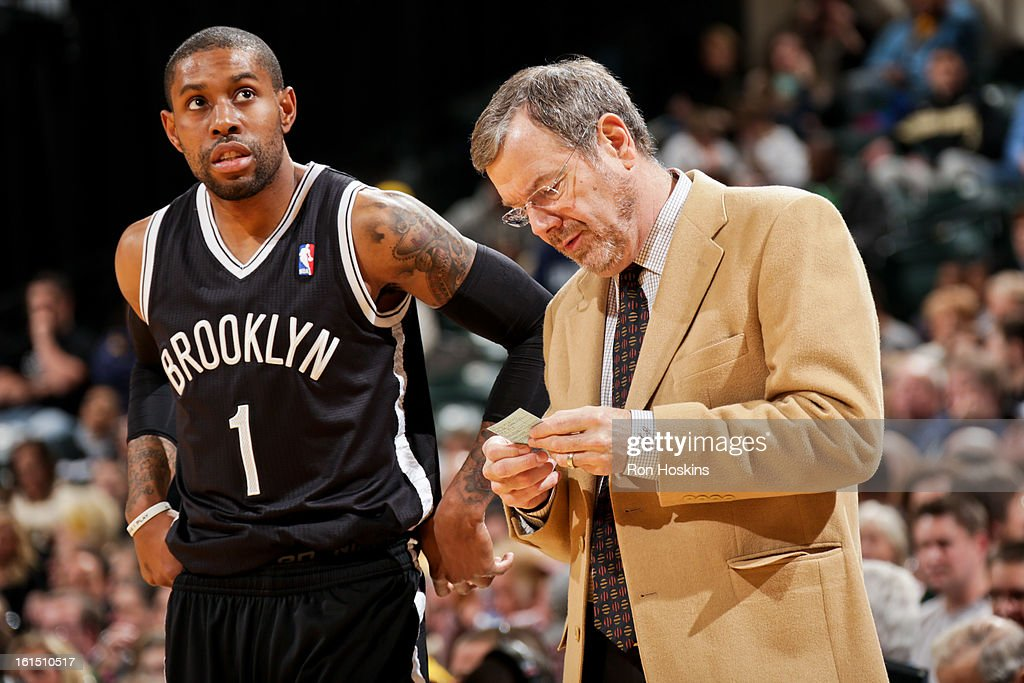 Interim Head Coach <a gi-track='captionPersonalityLinkClicked' href=/galleries/search?phrase=P.J.+Carlesimo&family=editorial&specificpeople=243247 ng-click='$event.stopPropagation()'>P.J. Carlesimo</a> of the Brooklyn Nets looks up a play with <a gi-track='captionPersonalityLinkClicked' href=/galleries/search?phrase=C.J.+Watson&family=editorial&specificpeople=740190 ng-click='$event.stopPropagation()'>C.J. Watson</a> #1 against the Indiana Pacers on February 11, 2013 at Bankers Life Fieldhouse in Indianapolis, Indiana.