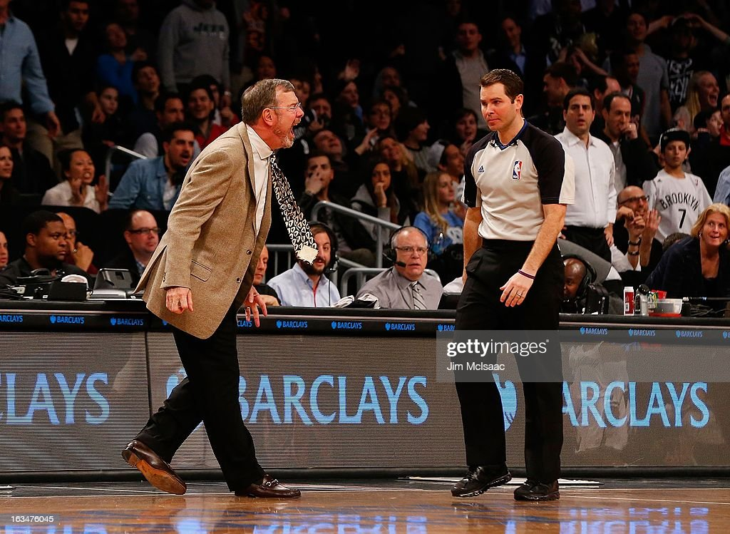 Interim head coach P.J. Carlesimo of the Brooklyn Nets shouts at referee Brian Forte during a break against the Milwaukee Bucks at Barclays Center on February 19, 2013 in the Brooklyn borough of New York City.The Nets defeated the Bucks 113-111 in overtime.