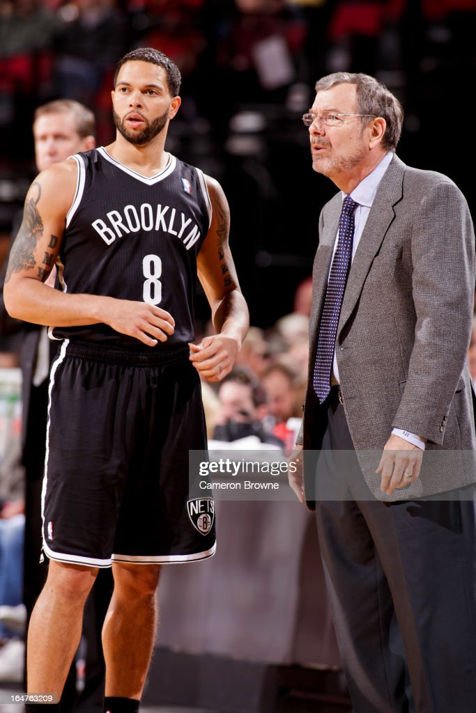 Interim Head Coach P.J. Carlesimo of the Brooklyn Nets speaks with Deron Williams #8 during a game against the Portland Trail Blazers on March 27, 2013 at the Rose Garden Arena in Portland, Oregon.
