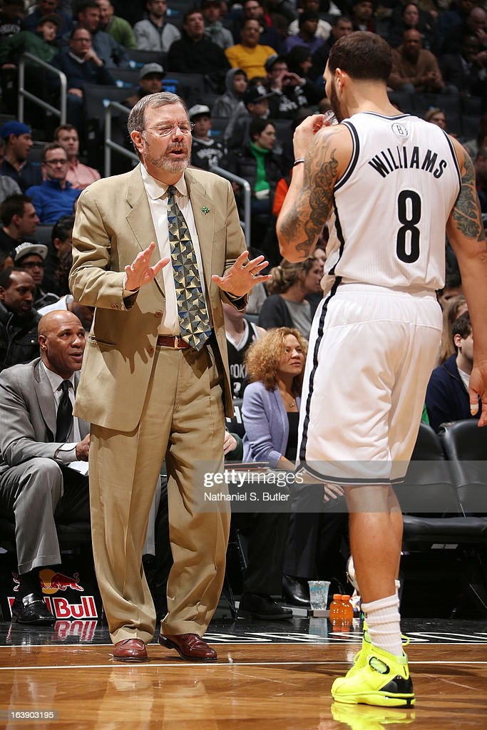 Interim Head Coach P.J. Carlesimo of the Brooklyn Nets speaks with Deron Williams #8 in a game against the Atlanta Hawks on March 17, 2013 at the Barclays Center in the Brooklyn borough of New York City.