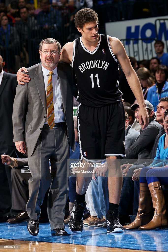 Interim Head Coach PJ Carlesimo of the Brooklyn Nets speaks with Brook Lopez while playing the Oklahoma City Thunder on January 2 2013 at the...