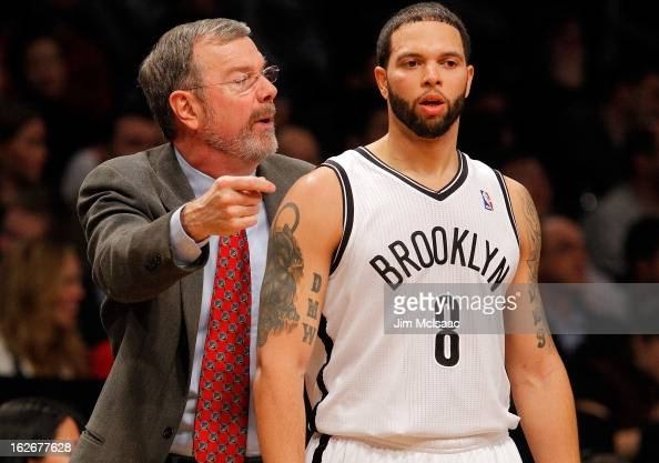 Interim head coach PJ Carlesimo of the Brooklyn Nets talks with Deron Williams during a time out against the Houston Rockets at Barclays Center on...