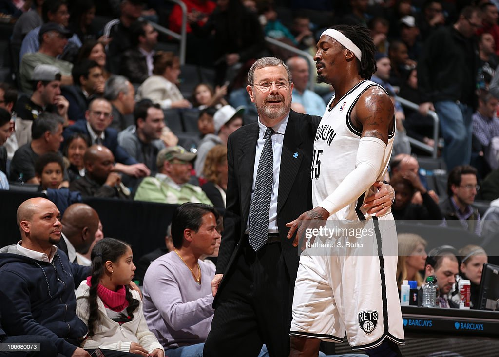 Interim Head Coach P.J. Carlesimo talks to his player Gerald Wallace #45 of the Brooklyn Nets during a game against the Washington Wizards on April 15, 2013 at the Barclays Center in the Brooklyn borough of New York City.