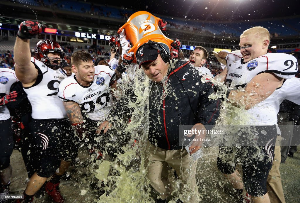 Interim head coach Steve Stripling of the Cincinnati Bearcats is dunked in Gatorade after defeating the Duke Blue Devils 48-34 during their game at Bank of America Stadium on December 27, 2012 in Charlotte, North Carolina.
