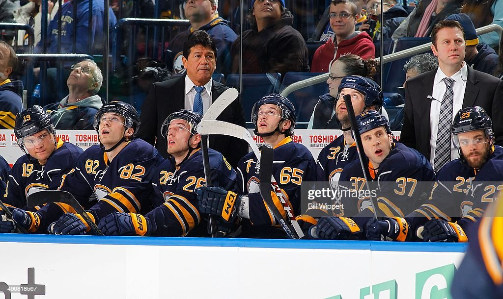 Interim head coach Ted Nolan and assistant head coach Joe Sacco of the Buffalo Sabres watch the action against the Florida Panthers on January 21...