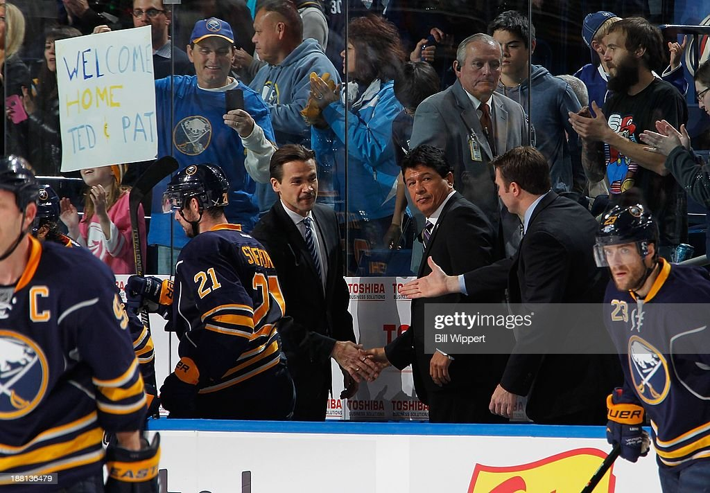 Interim head coach <a gi-track='captionPersonalityLinkClicked' href=/galleries/search?phrase=Ted+Nolan&family=editorial&specificpeople=540388 ng-click='$event.stopPropagation()'>Ted Nolan</a> (C) of the Buffalo Sabres celebrates a 3-1 victory over the Toronto Maple Leafs with assistant coaches <a gi-track='captionPersonalityLinkClicked' href=/galleries/search?phrase=Teppo+Numminen&family=editorial&specificpeople=204532 ng-click='$event.stopPropagation()'>Teppo Numminen</a> (L) and <a gi-track='captionPersonalityLinkClicked' href=/galleries/search?phrase=Joe+Sacco+-+Ice+Hockey+Coach&family=editorial&specificpeople=223879 ng-click='$event.stopPropagation()'>Joe Sacco</a> (R) on November 15, 2013 at the First Niagara Center in Buffalo, New York.