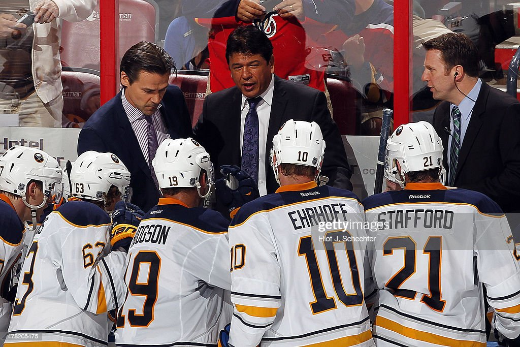 Interim Head Coach Ted Nolan of the Buffalo Sabres directs his team from the bench against the Florida Panthers at the BBT Center on March 7 2014 in...
