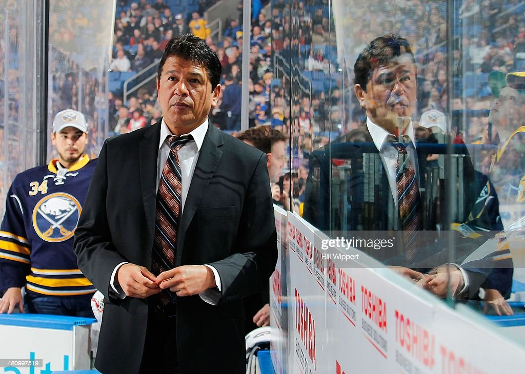Interim head coach Ted Nolan of the Buffalo Sabres walks to the bench for a game against the Nashville Predators on March 11 2014 at the First...