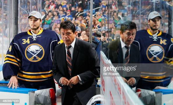 Interim head coach Ted Nolan of the Buffalo Sabres walks to the bench alongside Michal Neuvirth for a game against the Nashville Predators on March...