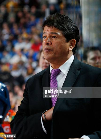Interim head coach Ted Nolan of the Buffalo Sabres watches the action against the Boston Bruins on February 26 2014 at the First Niagara Center in...