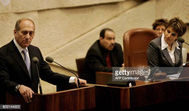 Interim Israeli Prime Minister Ehud Olmert is watched by Dalia Itzik during his speechs at the Israeli parliament in Jerusalem 04 May 2006 The...